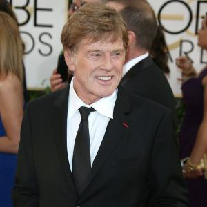 Robert Redford reacts to his Oscar