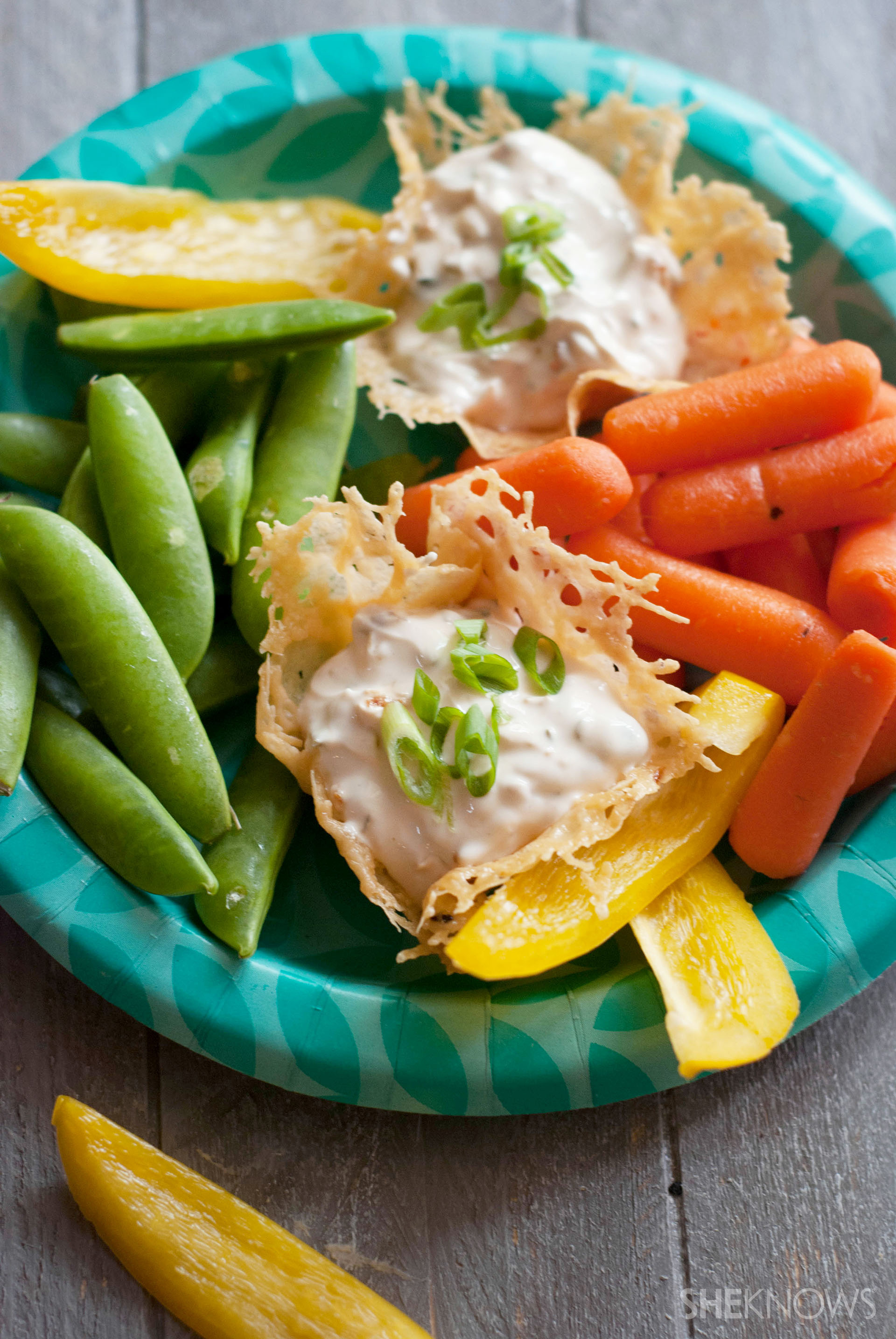 Parmesan cheese cups with onion dip and fresh veggies