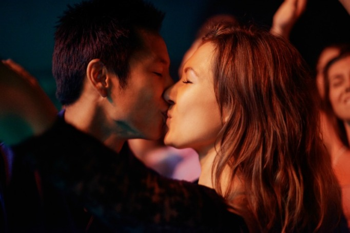 couple kissing in a club