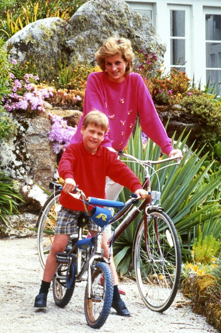 Diana, Princess of Wales with son Prince William, prepare for a cycling trip in Tresco during their holiday in the Scilly Isles