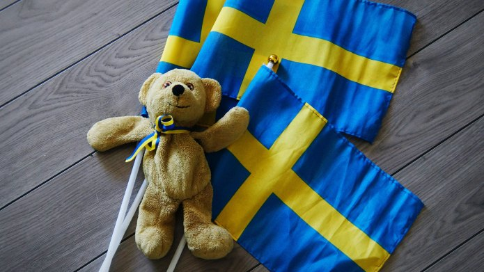 Close-up of teddy bear with Swedish