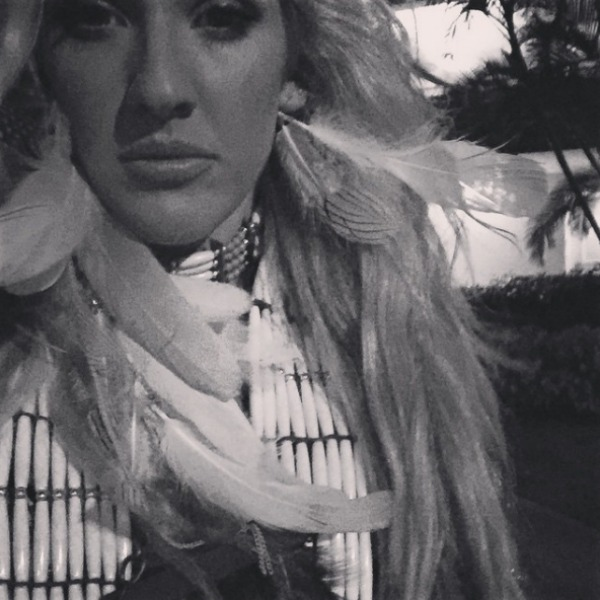 Ellie Goulding wearing feather headdress