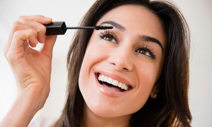 Close up of woman applying makeup