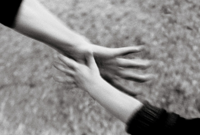 Two Hands Reaching