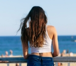 Brunette in Barceloneta at sunset