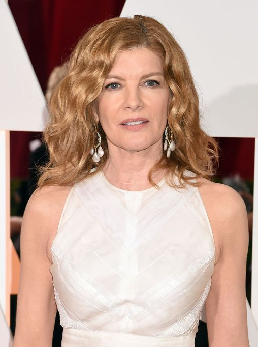 Rene Russo in a white dress