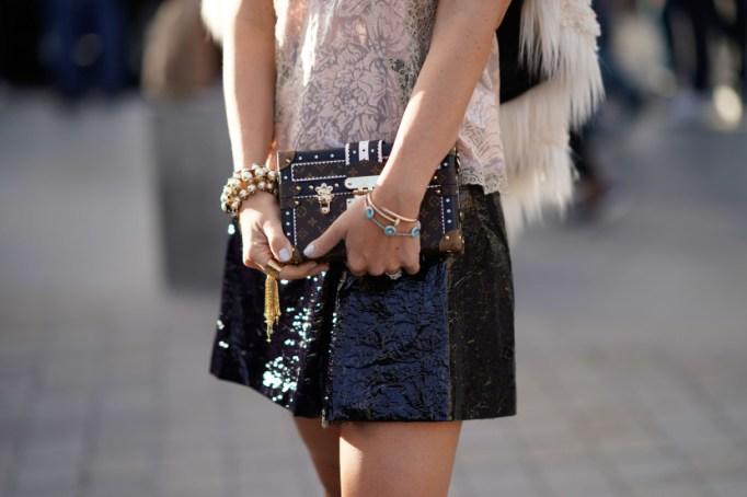 Assorted bracelets Leather mini skirt