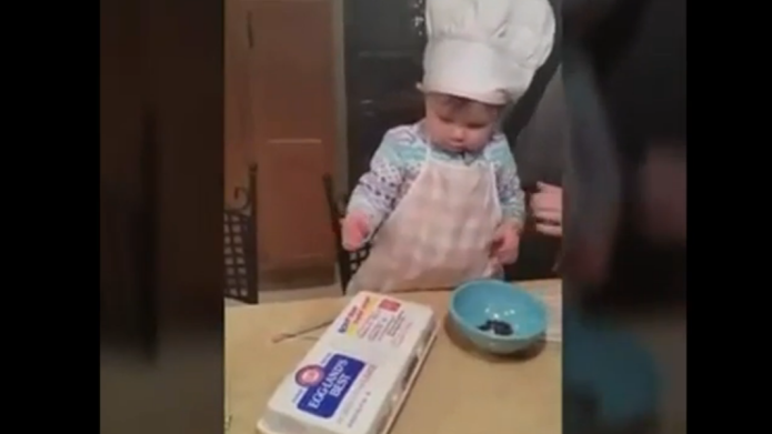 Toddler flawlessly cracks egg, we feel