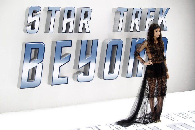 Sofia Boutella posing in front of the new Star Trek title