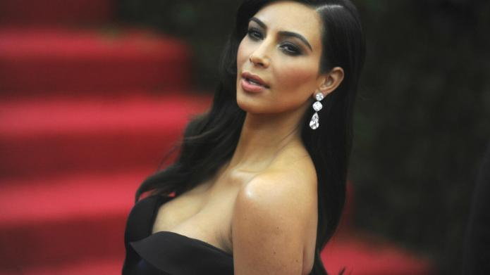 Kim Kardashian shows off pre-wedding abs