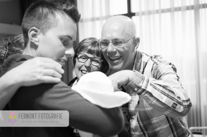 Photos of new grandparents meeting baby