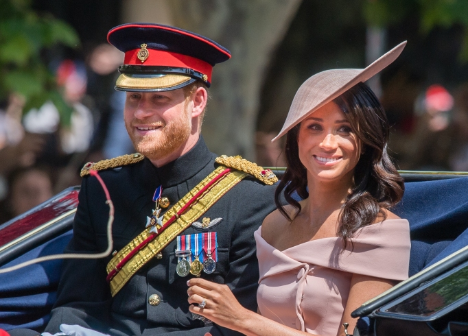 Prince Harry and Meghan Markle ride by carriage at Trooping the Colour 2018