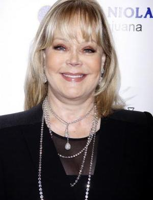 In the money: Candy Spelling wins