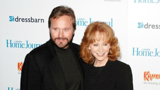 Reba McEntire and ex-husband Narvel Blackstone posing on a red carpet