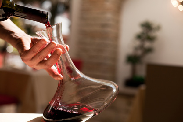 Wine being poured into decanter