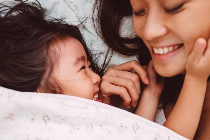 Mom & child playing joyfully on