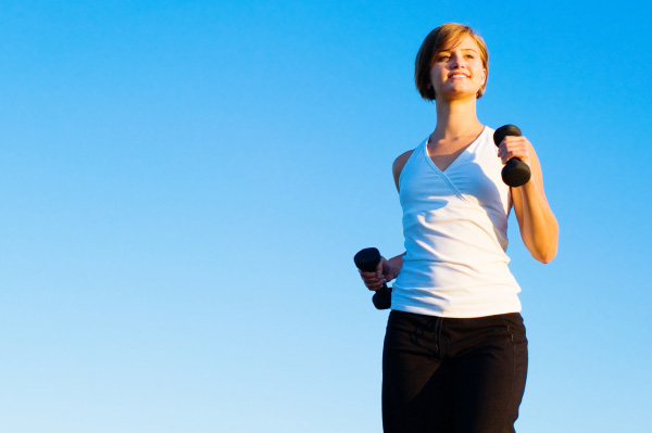 woman power walking with weights