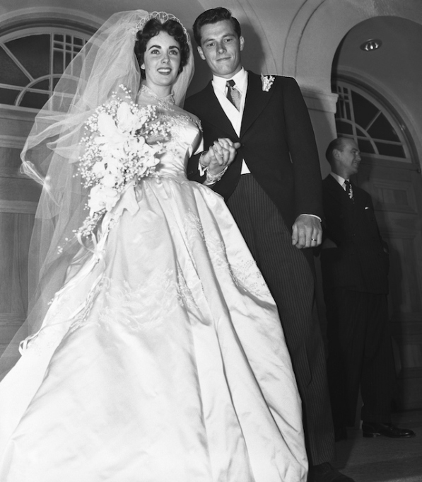 Mr. and Mrs. Conrad Hilton Jr., pause on the steps of the Church of the Good Shepherd here after their wedding