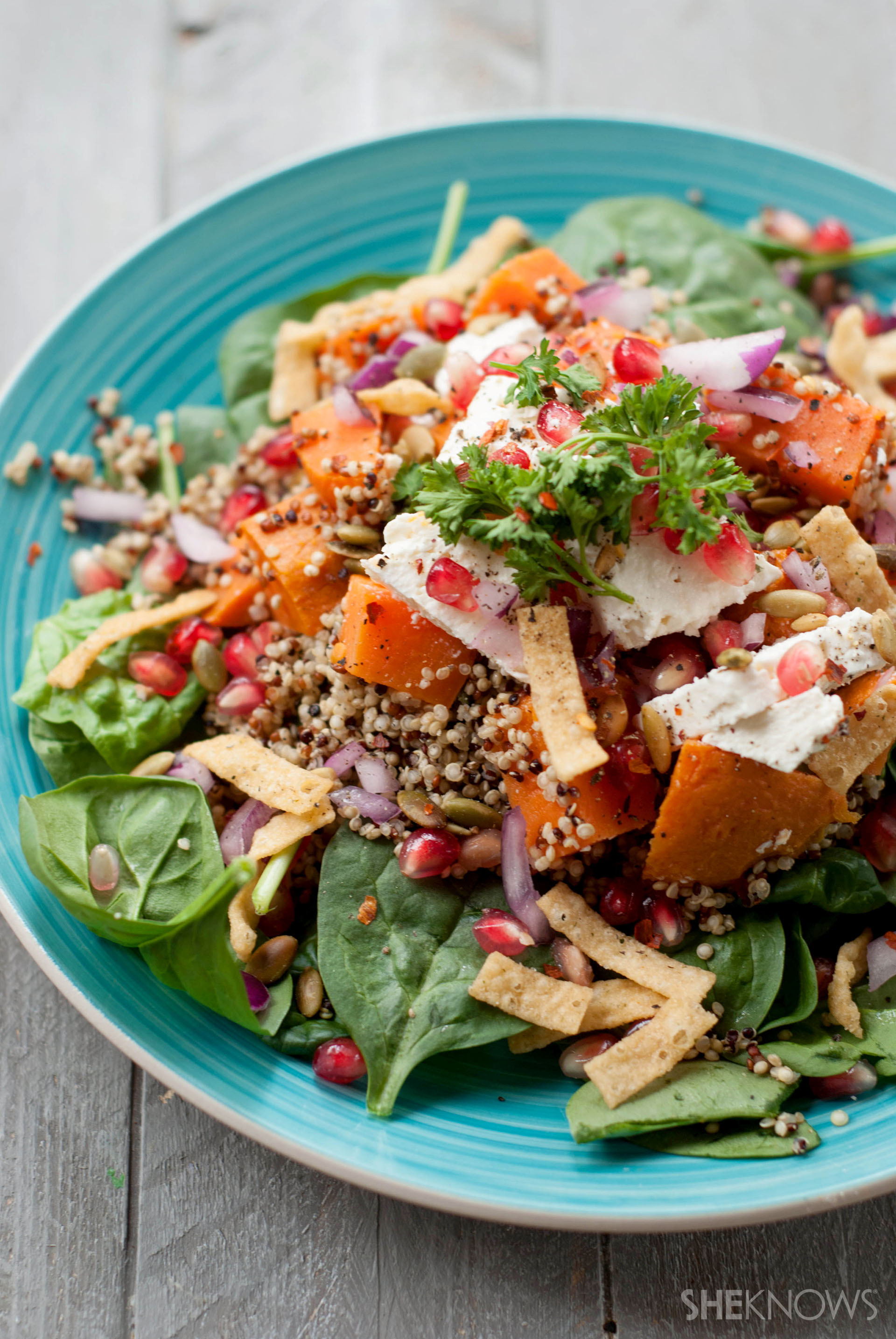 Rustic warm roasted pumpkin quinoa with spinach and spicy feta cheese