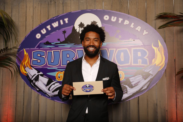 Wendell Holland holds his million dollar check at Survivor: Ghost Island finale
