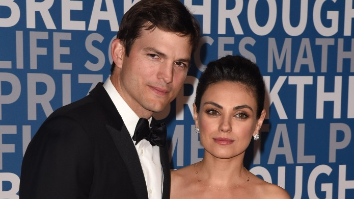 Ashton Kutcher and Mila Kunis attend