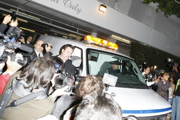 Whitney Houston's body is removed from the Beverly Hilton Hotel
