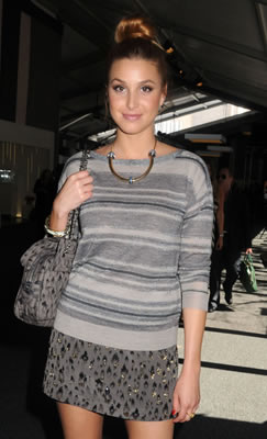Whitney Port in grey mini skirt and striped sweater at fashion week 2011
