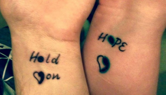 Creative semicolon tattoo on wrists
