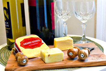 Wine and cheese on cutting board