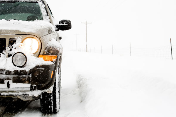Vehicle sitting in snowy weather