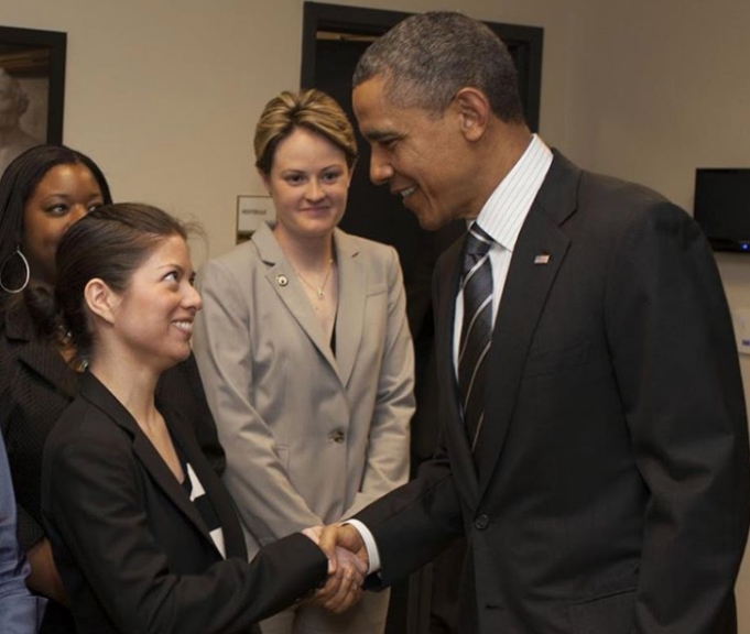 Natalia Oberti Noguera shaking hands with Obama