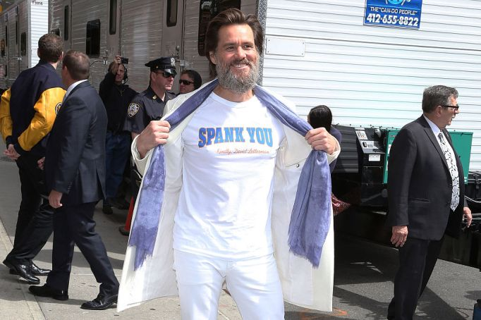 Jim Carrey in a T-shirt and white jeans