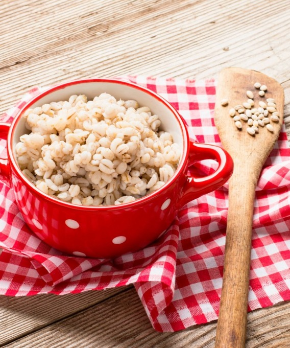 barley in red bowl and spatula