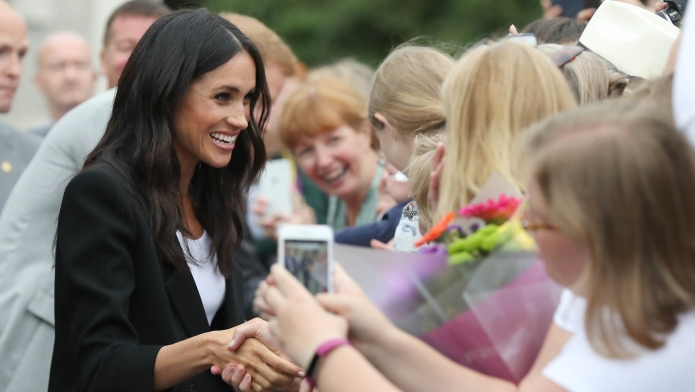 Meghan, Duchess of Sussex, greets fans