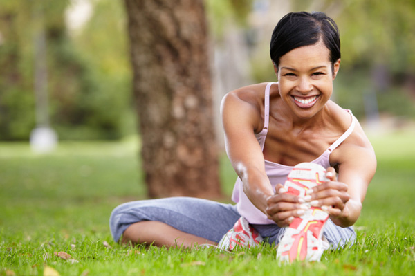Woman in her 40s stretching