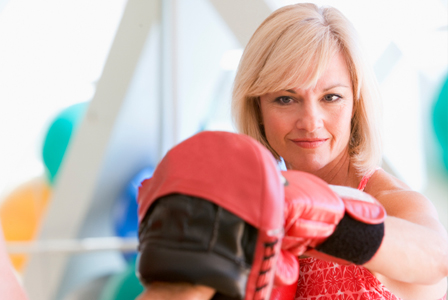 Woman in her 50s boxing