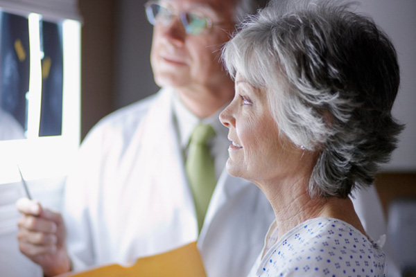Woman in her 50s speaking with doctor