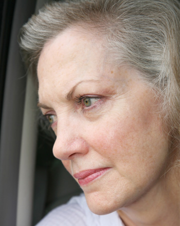 Woman in her sixties thinking