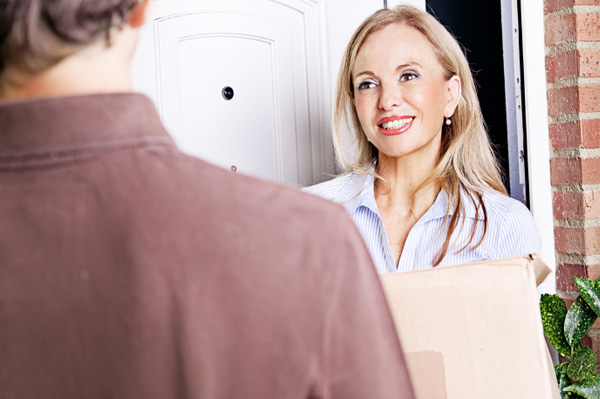 Woman accepting package delivery