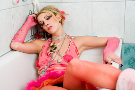 Woman with hangover in tub