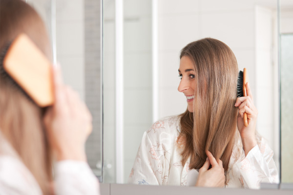 Woman caring for her dry and damaged hair