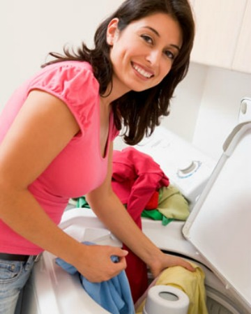 Woman loading the washer