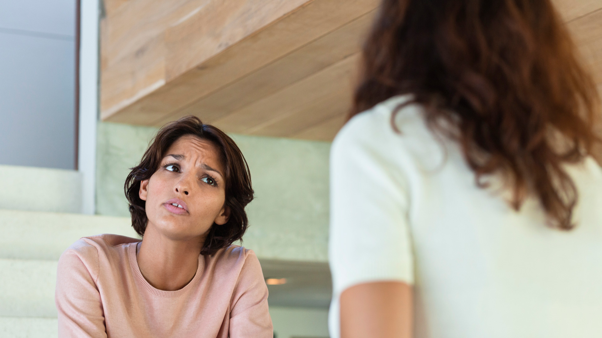 Woman annoyed with friend
