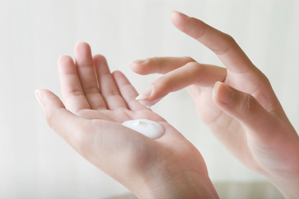 woman with lotion on hands