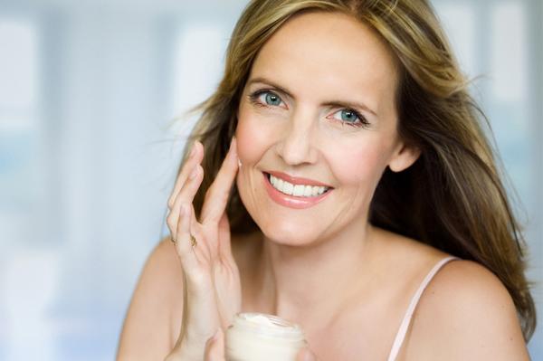 Woman with anti-agin cream