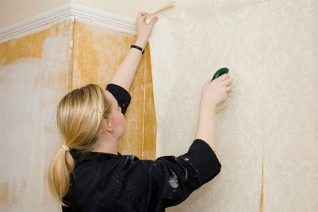 Applying wallpaper in the kitchen