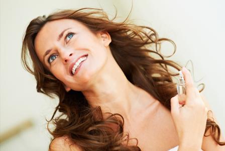 Woman applying winter perfume
