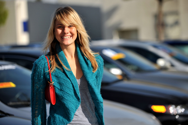 Woman at Car Dealership