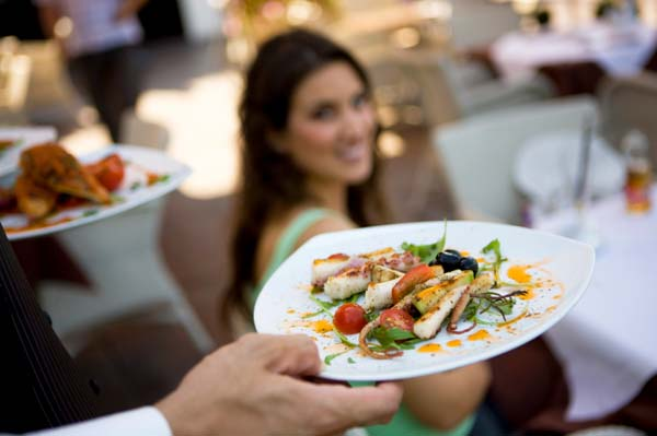 woman being served food at a restaurant