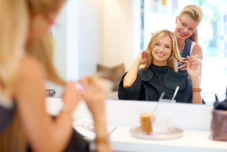 Woman getting hair cut